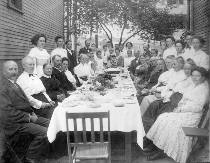 Black And White Photo Of Very Large Family Seated At Table For Picnic, Table  Is